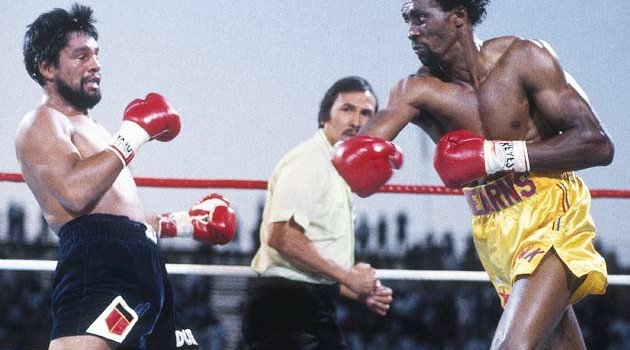 Roberto Duran reels from a Thomas Hearns right during their short 1984 bout.