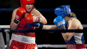 Spencer (left) grimaces as she throws a left hook at an advancing Fortin.