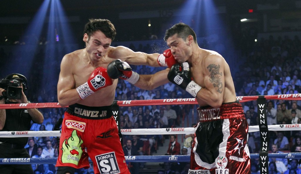WBC middleweight champion Julio Cesar Chavez Jr. of Mexico fights against Sergio Martinez of Argentina during their title fight at the Thomas & Mack Center in Las Vegas